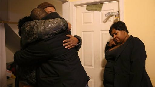 Melvin Jones, facing camera, hugs Robin Andrews, both brothers of Bettie Jones, 55, in Jones' living room after she was shot and killed by a Chicago police officer in Chicago on Saturday. A Chicago police officer shot and killed Jones and a man while responding to a domestic disturbance call in the neighborhood on the city's West Side, police said. (Abel Uribe/Chicago Tribune)