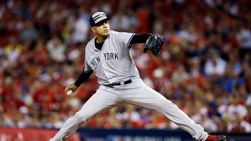 American League's Dellin Betances, of the New York Yankees, throws during the seventh inning of the MLB All-Star baseball game, Tuesday, July 14, 2015, in Cincinnati. (AP Photo/John Minchillo)