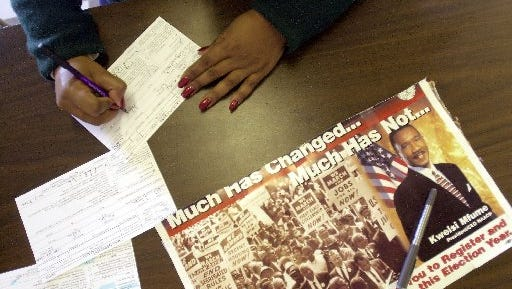 A Henderson resident registers to vote at the JFK Center