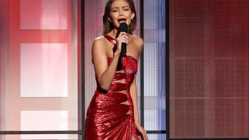 Host Gigi Hadid impersonates Melania Trump at the American Music Awards at the Microsoft Theater on Sunday, Nov. 20, 2016, in Los Angeles.