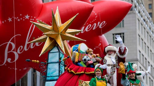 Santa Claus waves to spectators along Central Park West during the Macy's Thanksgiving Day Parade in New York Thursday, Nov. 24, 2016.