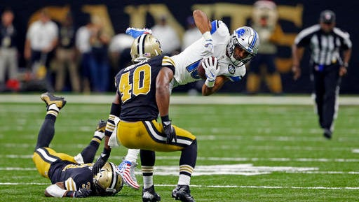 Detroit Lions wide receiver Golden Tate (15) is tripped up by New Orleans Saints free safety Jairus Byrd (31) as cornerback Delvin Breaux (40) covers in the first half of an NFL football game in New Orleans, Sunday, Dec. 4, 2016. (AP Photo/Butch Dill)