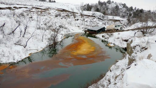 This Dec. 10, 2016 photo provided by the North Dakota Department of Health shows an oil spill from the Belle Fourche Pipeline that was discovered Dec. 5 in Ash Coulee Creek, a tributary of the Little Missouri River, near Belfield, N.D. The discovery of the pipeline spill in western North Dakota has drawn heightened attention because of the battle over the Dakota Access oil pipeline being built across the state.