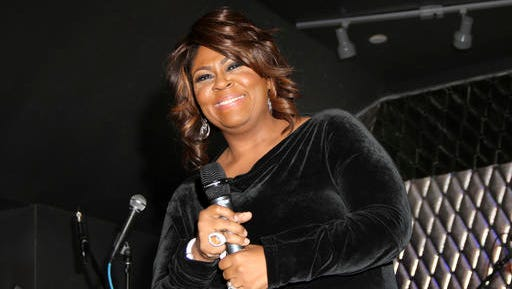FILE - In this Feb. 7, 2013 file photo, Kim Burrell performs during For the Love of R&B - A Tribute to Whitney Houston at Tru Hollywood, in Los Angeles. The performing rights organization BMI is the latest group to distance itself from gospel singer Burrell after video surfaced of her referring to gays and lesbians as perverted. A statement from BMI released on Friday, Jan. 6, 2017, said Burrell will no longer be honored and she was asked not to attend their annual BMI Trailblazers of Gospel Music event scheduled for Jan. 14, in Atlanta, Georgia. (Photo by Arnold Turner/Invision/AP, File)