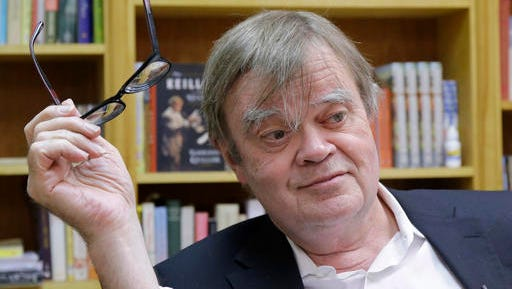 "FILE - In this April 29, 2014 Garrison Keillor appears in his St. Paul, Minn., office. Keillor will hit the road this spring to celebrate Minnesota Public Radio's 50th anniversary. Keillor says his one-man ""The Gratitude Tour"" will visit five Minnesota cities in six days in April."