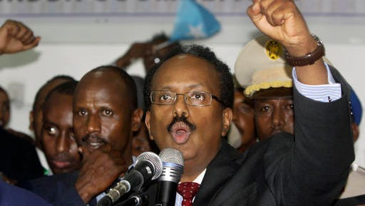 New Somali President Mohamed Abdullahi Farmajo celebrates winning the election and taking office in Mogadishu, Somalia Wednesday, Feb. 8, 2017. Former prime minister Farmajo who holds dual Somali-U.S. citizenship was declared Somalia's new president Wednesday, immediately taking the oath of office as the long-chaotic country moved toward its first fully functioning central government in a quarter-century.