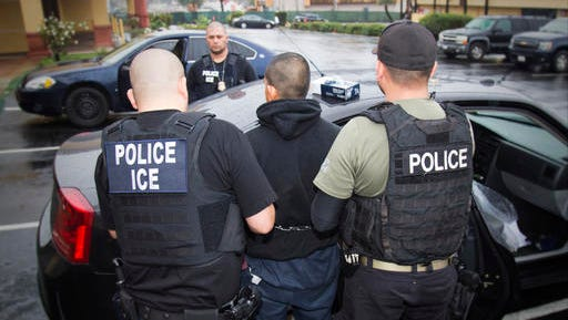 In this photo taken Feb. 7, 2017, released by U.S. Immigration and Customs Enforcement, an arrest is made during a targeted enforcement operation conducted by U.S. Immigration and Customs Enforcement (ICE) aimed at immigration fugitives, re-entrants and at-large criminal aliens in Los Angeles. The Trump administration is wholesale rewriting the U.S. immigration enforcement priorities, broadly expanding the number of immigrants living in the U.S. illegally who are priorities for deportation, according to a pair of enforcement memos released Tuesday, Feb. 21, 2017.