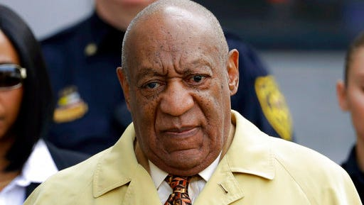 """FILE - In this Feb. 27, 2017, file photo, Bill Cosby departs after a pretrial hearing in his sexual assault case at the Montgomery County Courthouse in Norristown, Pa. Prosecutors hoping to use Bill Cosby's explosive deposition testimony about getting quaaludes to give women in his sexual-assault trial also want to use references he made about trying to slip women the aphrodisiac Spanish fly. In a court filing Thursday, March 30, 2017, they quote Cosby making Spanish fly references in his 1991 book """"Childhood"""" and in an interview that year with Larry King. They say the comments show his familiarity with date rape drugs."""