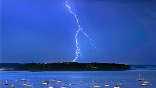 FILE - In this Sept. 11, 2013 file photo, lightning strikes north of Macworth Island in Portland, Maine. A new study says flashes of lightning in the US will likely increase by nearly 50 percent by the end of the century because of global warming. Scientists found a mathematical formula that equates lightning to the rain rate and how much moist energy is in a storm cloud. Then using that formula researchers applied basic physics to show that for every degree Fahrenheit the world warms, lightning strikes will go up nearly 7 percent (12 percent for every degree Celsius). (AP Photo/Robert F. Bukaty, File)