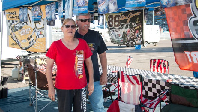 Betty and Paul Adkins stand together on their campsite near Phoenix International Raceway on Nov. 8, 2017.