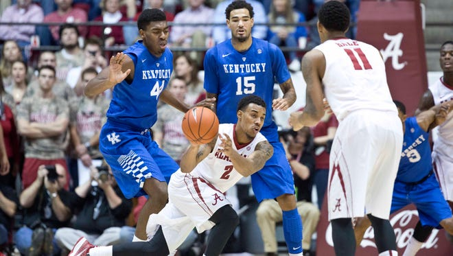 Alabama guard Ricky Tarrant (2) attempts a pass to teammate Shannon Hale (11) as Kentucky center Dakari Johnson (44) and forward Willie Cauley-Stein (15) defend during the second half of an NCAA college basketball game, Saturday, Jan. 17, 2015, in Tuscaloosa, Ala. Kentucky won 70-48. (AP Photo/Brynn Anderson)