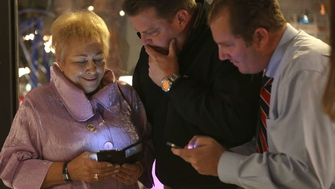 Ginny Foat looks over early election results with campaign staff Jim Stewart, center, and Toby Holmes during a post election party at Eight4nine restaurant in Palm Springs, Tuesday, November 3, 2015.