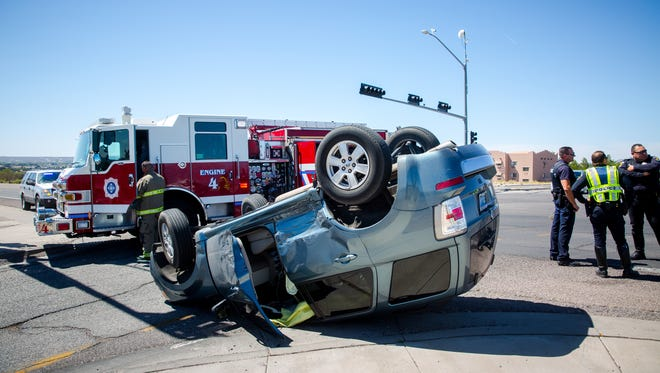 A Mercury SUV is crumpled after rolling over during a two-vehicle crash on University Avenue near the Interstate 25 exit, April 14, 2016. No series injuries were reported.