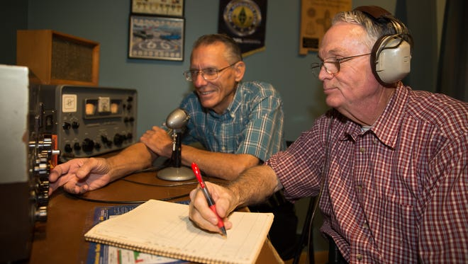Mesilla Valley Radio Club members Robert Bennett, right, and Charlie Welch, left, test out a 1950s amateur radio set up, also known as a ham station at the Branigan Cultural Center. The 1950s amateur radio set up includes a Johnson Viking II Transmitter and a Hammarlund HQ-One Seventy Companion Receiver.