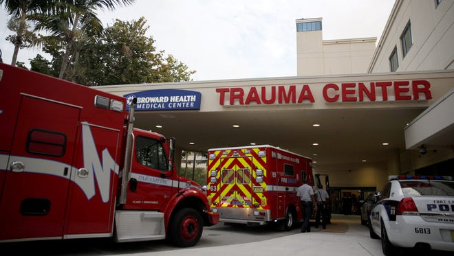 Emergency vehicles sit out the the Broward Health Medical Center Trauma Center in Fort Lauderdale, Fla., Friday, January 6, 2017. Shooting victims from the Fort Lauderdale-Hollywood International Airport were taken here for treatment.