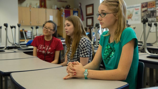 Aretha Deng,18, left, Emily  Deruyter, 17, center and Lara Teich,17, right, discuss the Academic WorldQuest Team at Las Cruces High School on Wednesday April 5, 2017.