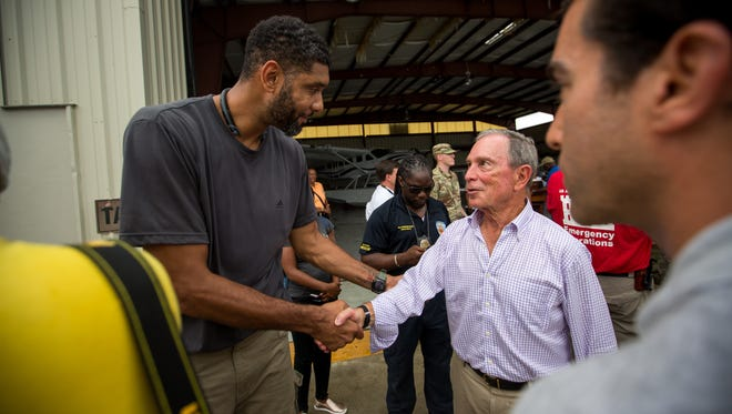 Michael Bloomberg, founder of Bloomberg LP,, right, shakes hands with Tim Duncan, former NBA player, left,  after a press conference, where they announced the launch of www.usvirecovery.org, at the Cyril E. King Airport on St. Thomas, U.S. Virgin Islands, on Sept. 14, 2017.