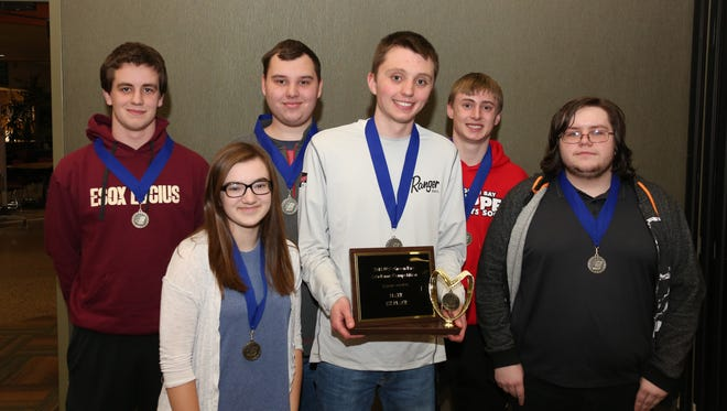 Sturgeon Bay students pose with trophy. Front row: Emily Tess, left, Jack Richard and Michael Grahn. Back row: James Dickson, left, Liam Herbst and DJ Reichel.