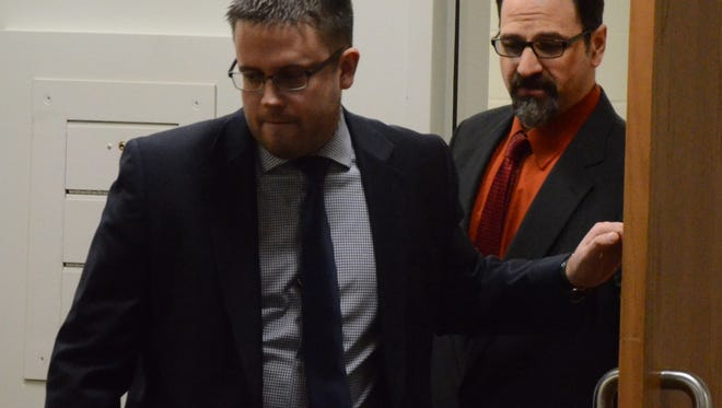 Attorney Josh Blanchard leads Troy Estree into the courtroom Wednesday before Estree learned he was acquitted of rape.