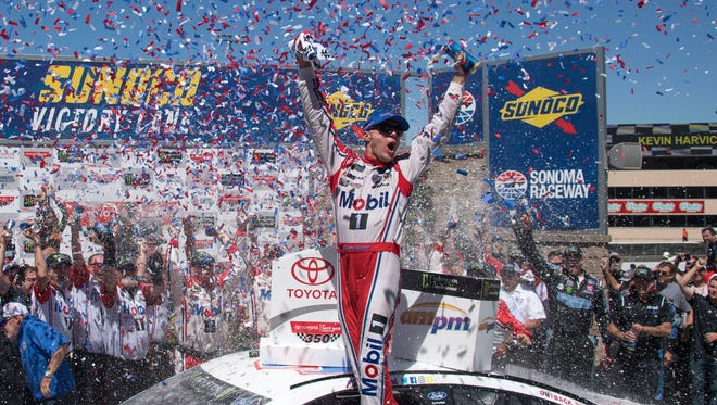 Kevin Harvick celebrates in victory lane after winning the Toyota/Save Mart 350 at Sonoma Raceway.