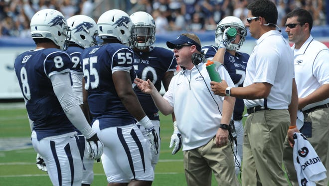 Nevada football coach Brian Polian talks with his defense during the Southern Utah game on Aug. 30.