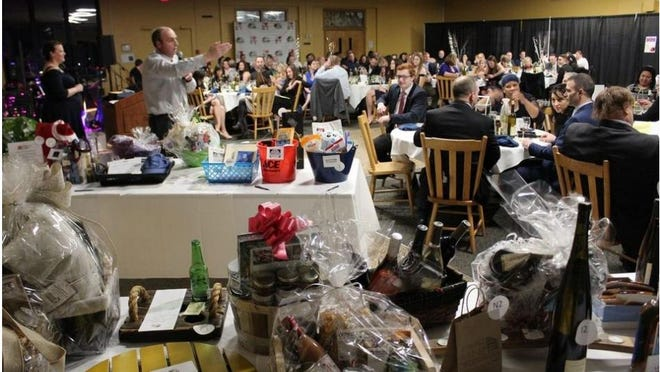 In person Chamber auctions like this past one with auctioneer Jere Horning aren't feasible during the pandemic.