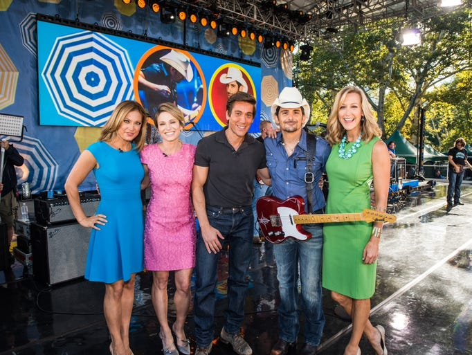 Brad Paisley brought songs from his just-released new album, Moonshine in the Trunk, to ABC's Good Morning America Summer Concert Series on August 29. (L-r):  GMA's Ginger Zee, Amy Robach, and David Muir; Paisley; and GMA's Lara Spencer.