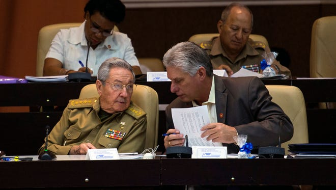 This handout picture released by Cuban official website www.cubadebate.cu shows Cuban President Raul Castro talking to Cuban First Vice President Miguel Diaz-Canel during a National Assembly session Dec. 21, 2017, in Havana.