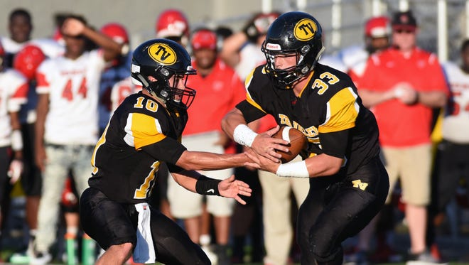 Tri-Valley's Bryce Farmer (33) takes the handoff from Andrew Newsom during the Scotties' 27-7 win over Marion-Franklin during a Week 1 game at Jack Anderson Stadium. The unbeaten Scotties host Zanesville tonight.
