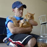 Man with 'assistance cats' has eviction reprieve