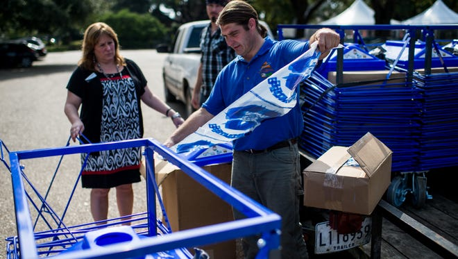 Greg Guidroz, recreation and education coordinator of the Bayou Vermilion District, demonstrates the process of lining a new compact recycling bin in preparation for Festivals Acadiens et Creoles at Girard Park in Lafayette, La., Thursday, Oct. 8, 2015. Guidroz and BVD secured a grant through Keep Louisiana Beautiful to establish a loaner program to provide up to 90 compact recycling bins to local festivals and events free of charge.
