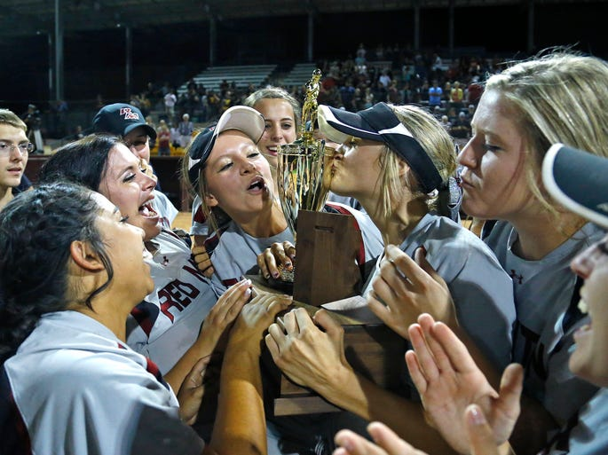 Red Mountain pitcher Breanna Macha kisses their trophy following their 8-1 win over Mountain Ridge in  their Division I softball state championship Monday, May 19, 2014in Tempe,  Ariz.