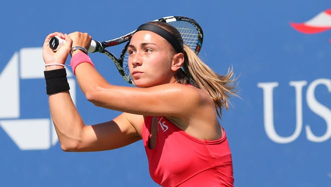 Aleksandra Krunic (SRB) returns a shot to Petra Kvitova (CZE) on Armstrong Stadium on day six of the 2014 U.S. Open tennis tournament at USTA Billie Jean King National Tennis Center.