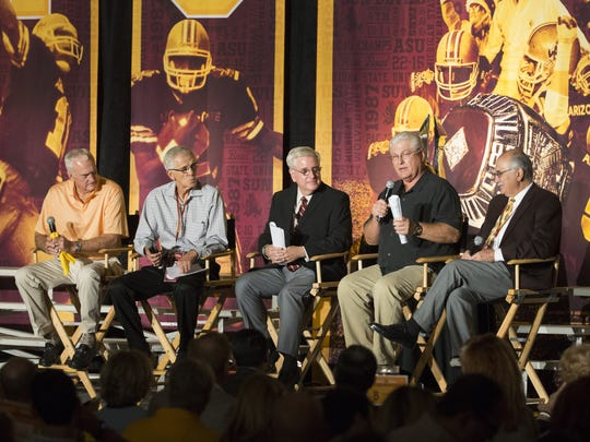Former ASU head football coach John Cooper,left,  Larry Marmie, former defensive coach, Tim Healey, host, Mike Martz, former wide receivers and quarterback coach and Don Bocchi, former assistant football coach, speak during ASU Legends Luncheon celebrating the 30th anniversary of the 1987 Rose Bowl champion team at Arizona Grand Resort in Phoenix on October 21, 2016.
