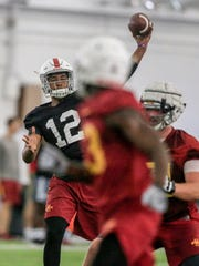 Iowa State's Devon Moore throws a pass in practice Monday, July 31, 2017.