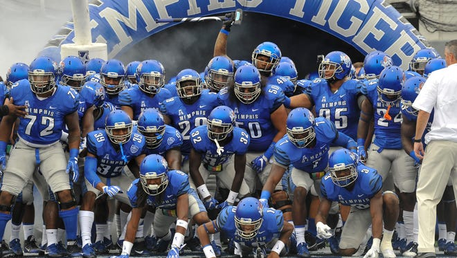 The Memphis Tigers wait to enter the field before a game against Kansas at the Liberty Bowl last season.
