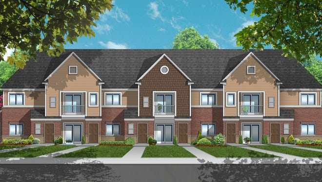 """A final architectural rendering of one of the apartment buildings to be called """"The Crossing at Lakeland Trail."""""""