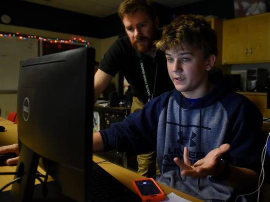 Nicholas Corum gets help from teacher Robert Winter during coding class at Carter Middle School Thursday, Oct. 26, 2017. Knox County Schools is pushing to get more students coding and has developed a dedicated computer science curriculum.
