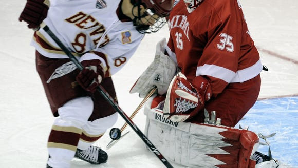 Miami (Ohio) goalie Ryan McKay (35) stops an attempted
