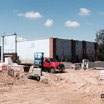 This new building in Biltmore Park will be home to a Starbucks that will open in September.