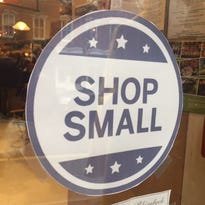"A ""Shop Small"" decal in a window at the Rhinebeck Department Store."