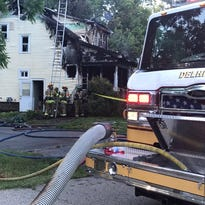 Candle may have caused fire that critically injured Holt man