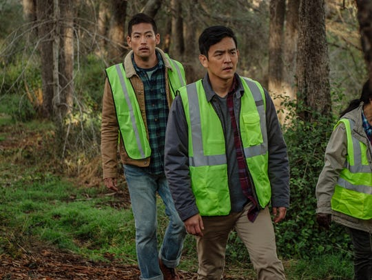 David (John Cho, right) searches for his missing daughter