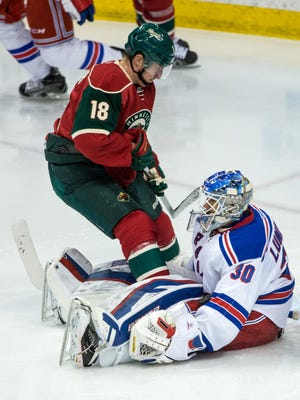 New York Rangers goalie Henrik Lundqvist (30) makes a save on Minnesota Wild forward Ryan Carter (18) during the third period at Xcel Energy Center.