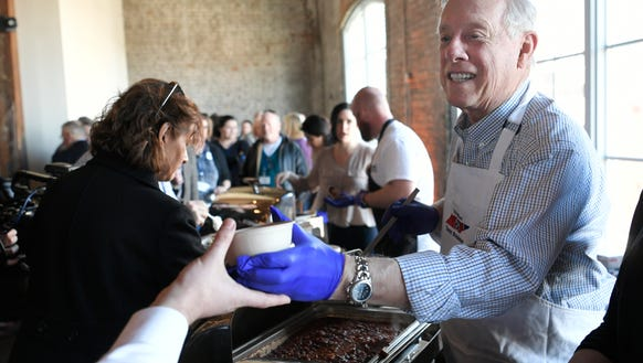 U.S. Senate candidate and former Tennessee governor Phil Bredesen serves chili to supporters during a campaign event at Acme Feed & Seed in Nashville March 3, 2018.