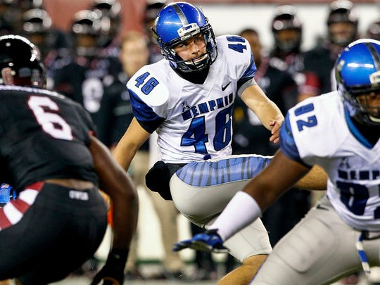 Memphis placekicker Jake Elliott kicks a field goal against Temple.