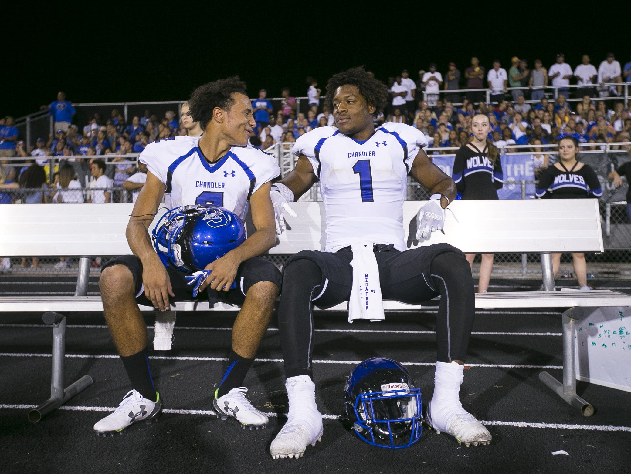 Chandler's Chase Lucas (2) and N'Keal Harry share a laugh up 35-0 early in the second quarter against Pinnacle at Pinnacle High School in Phoenix, AZ on Aug. 20, 2015.