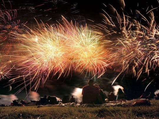 Fireworks explode in the air above Elmdale Airpark