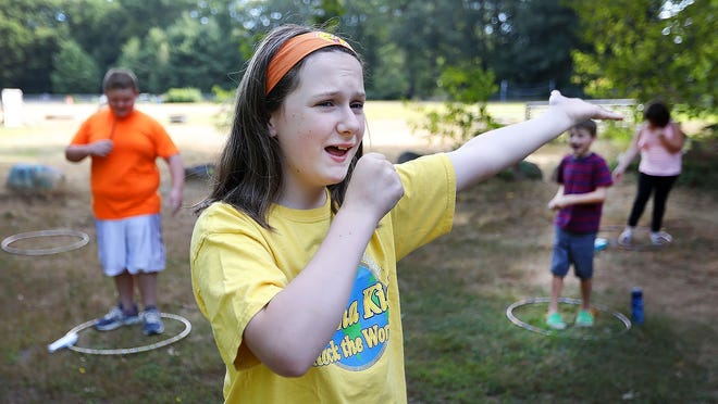 Jaclyn Mutchler, 12, of Hanover acts as a TV reporter at Hartsuff Park in Rockland on Thursday August 13, 2020. Greg Derr/The Patriot Ledger