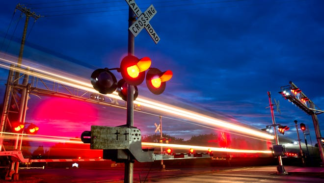 A train passes south through the railroad crossing at Oslo Road on September 23, 2014.